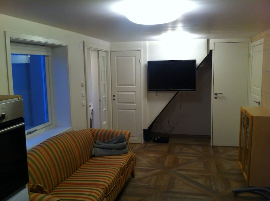 The TV is mounted on the wall and the stairs built in for improved noise-insulation.
