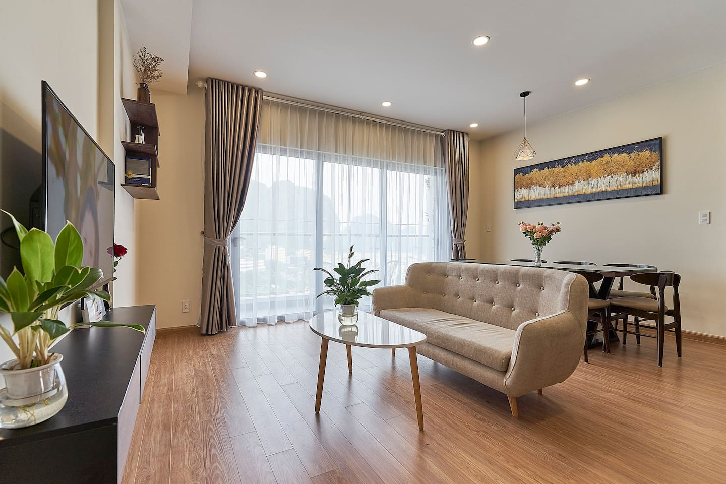 Full view of living room. Comfy sofa with great City and Sea view from the spacious living room. Smart Tv 50 inch with Netflix, Youtube