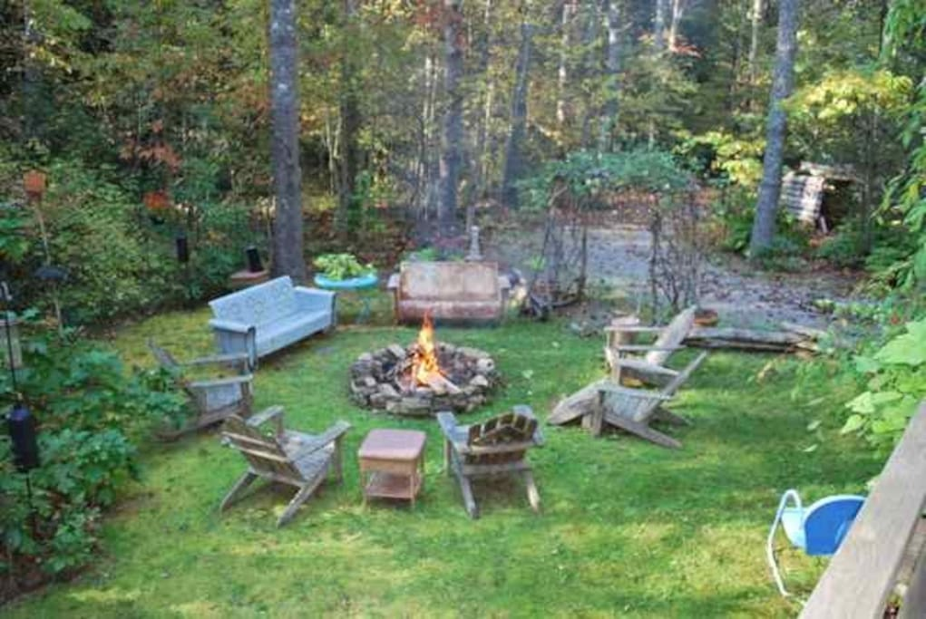 Side moss yard with fire pit.   Creek wraps around this area.  Heaven!