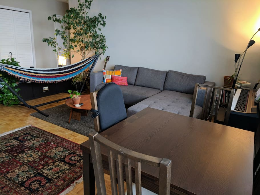 Living room with expandable dining room table.