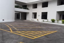 Up to three car parking included in the lower garage level. Close to ramp and elevator.