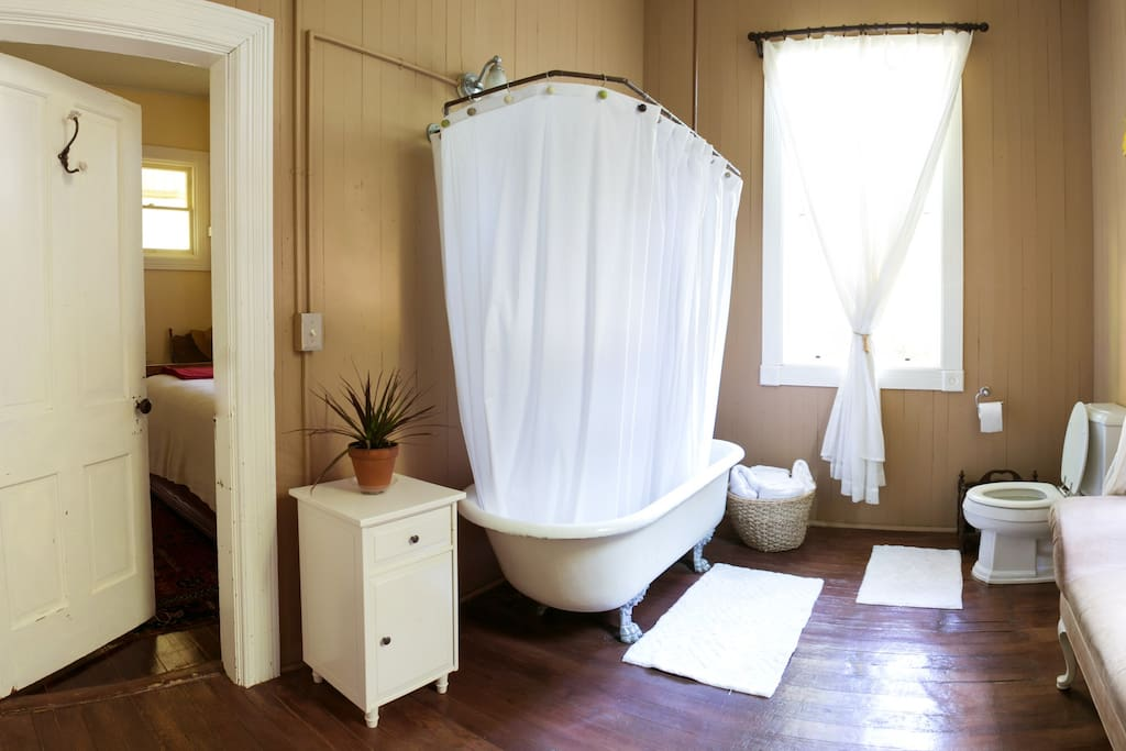 The shared bathroom with private entrance from the bedroom. The clawfoot tub is original to the house.