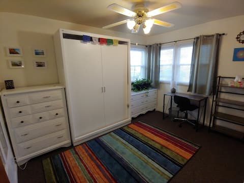 Bedroom with a lot of natural light & murphy bed