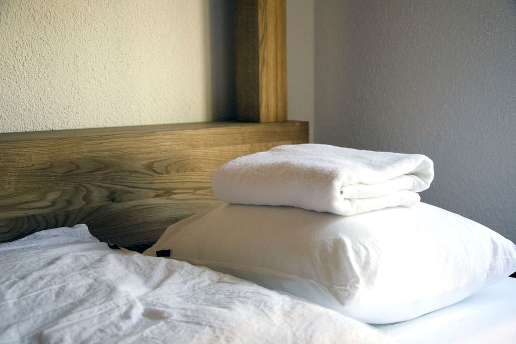 Bed with linen and towel