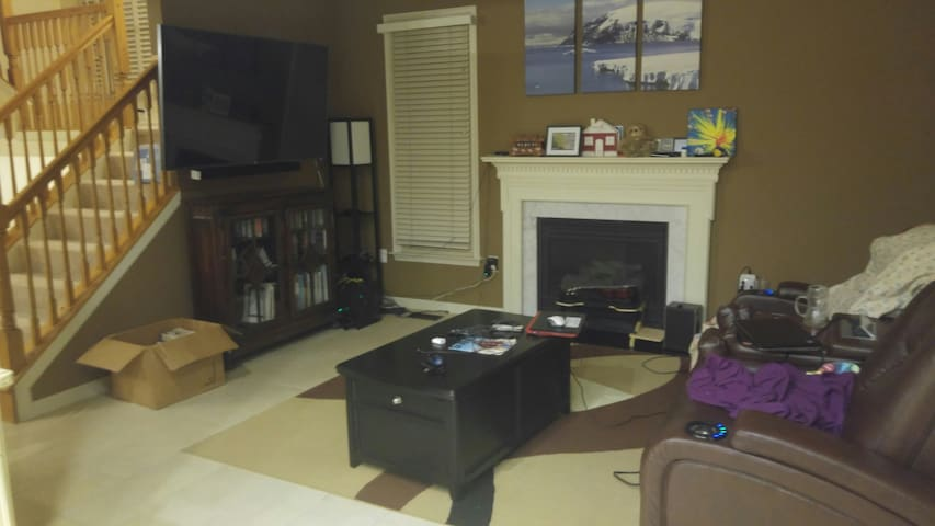 The family room is the main social area of the house, mostly thanks to the big TV and being right next to the kitchen.