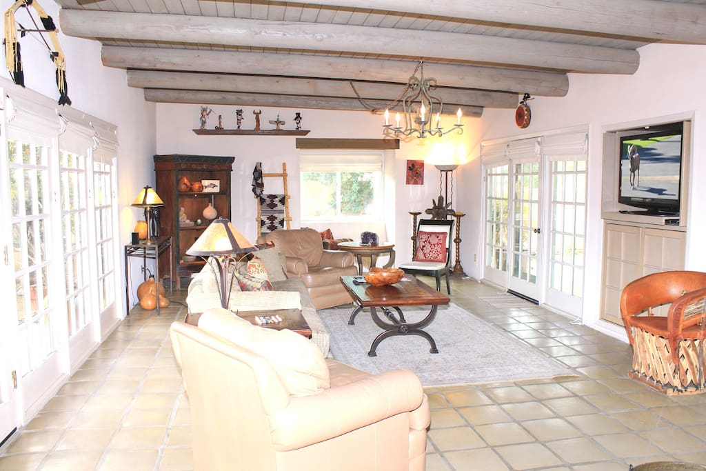 Follow the tiled floors and wood beams into our bright living room