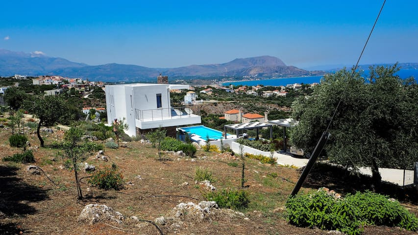 Looking from the gardens out over the house to Souda Bay & The White Mountains