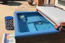 The hot tub accommodates 4 adults and is available year-round