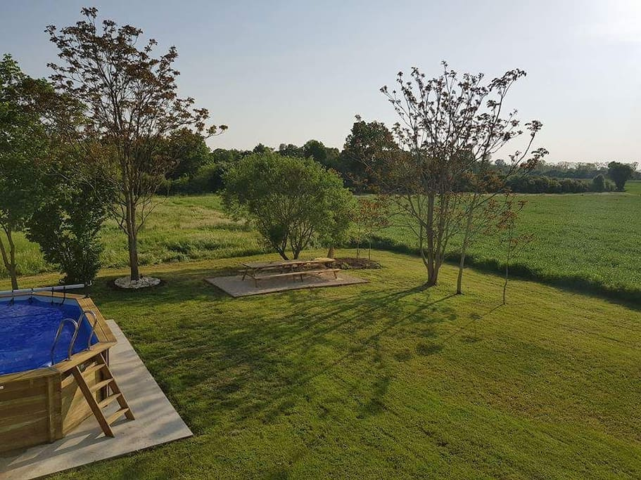 The rear garden directly adjoins The Marais Poitevin and benefits from a heated swimming pool, oudoor seated dining area under the natural shade of the trees, a large level lawn area and facing directly west to maximise those long sunny days.