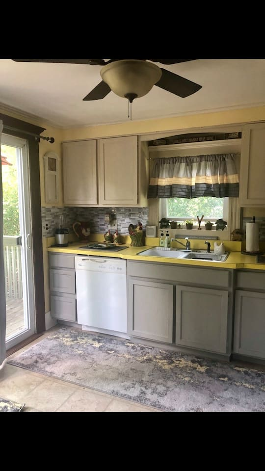 Full kitchen with microwave and dishwasher and breakfast bar.