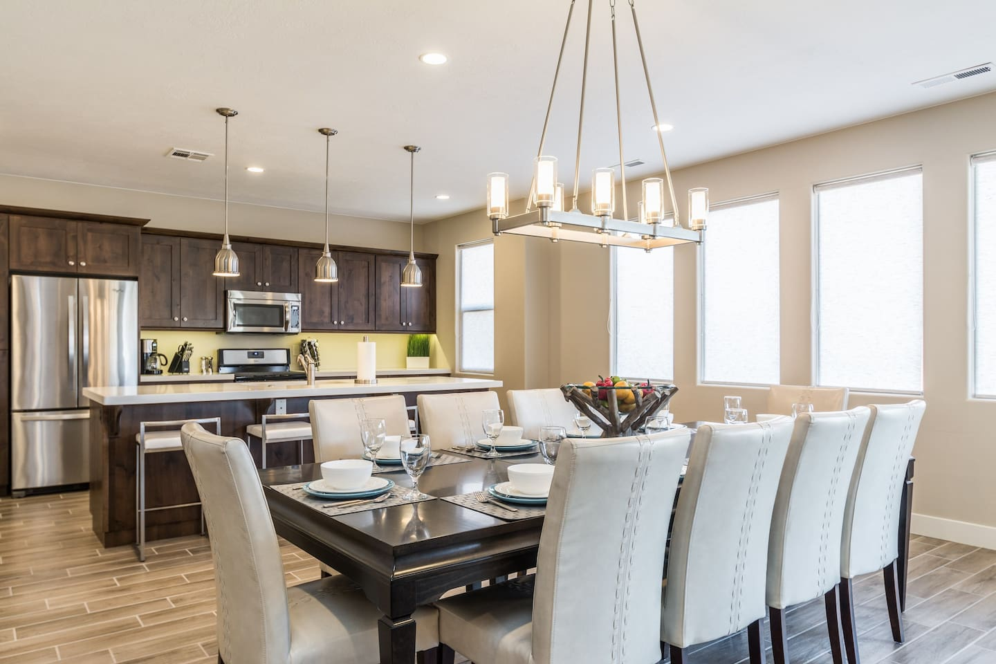 Dine up to 10 guests at the dining table and 4 at the kitchen island