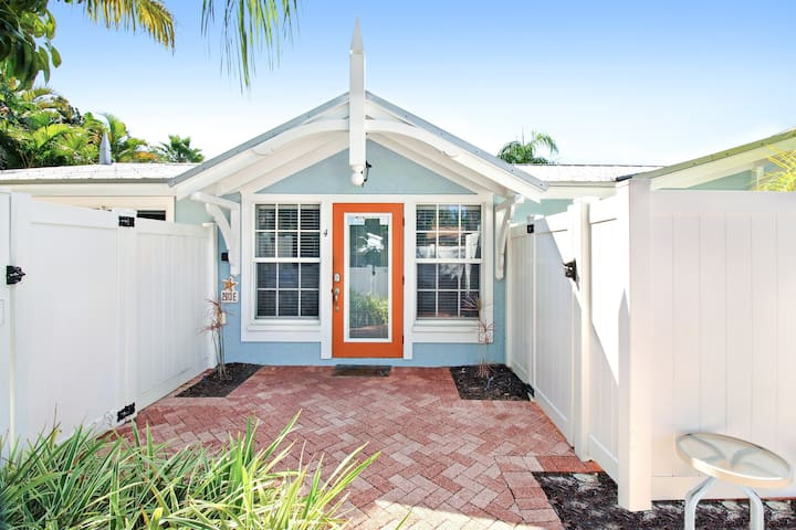Dog-friendly beach cottage moments from the gulf with shared pool, near trolley!
