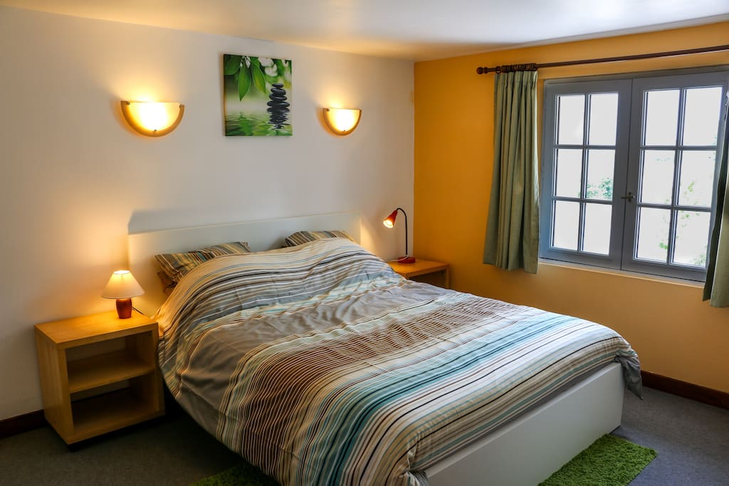 Double bedroom includes queen-sized bed and fantastic far-reaching views.