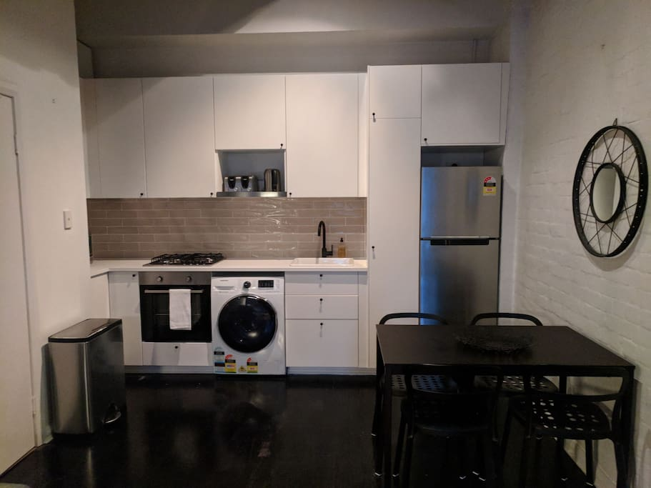 Newly renovated kitchen with Samsung fridge and washing/dryer (also new).
