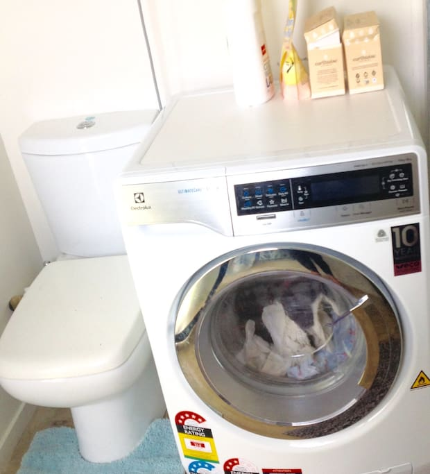 Bathroom and laundry area- washer dryer combo in one