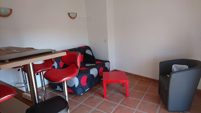 coin salon et canapé-lit