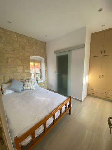 Second bedroom has a double bed. Behind the glass door is it's en-suite bathroom