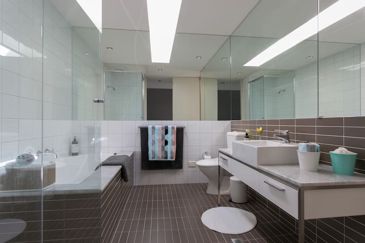 Main bathroom on Level 3 with a deep full size bath
