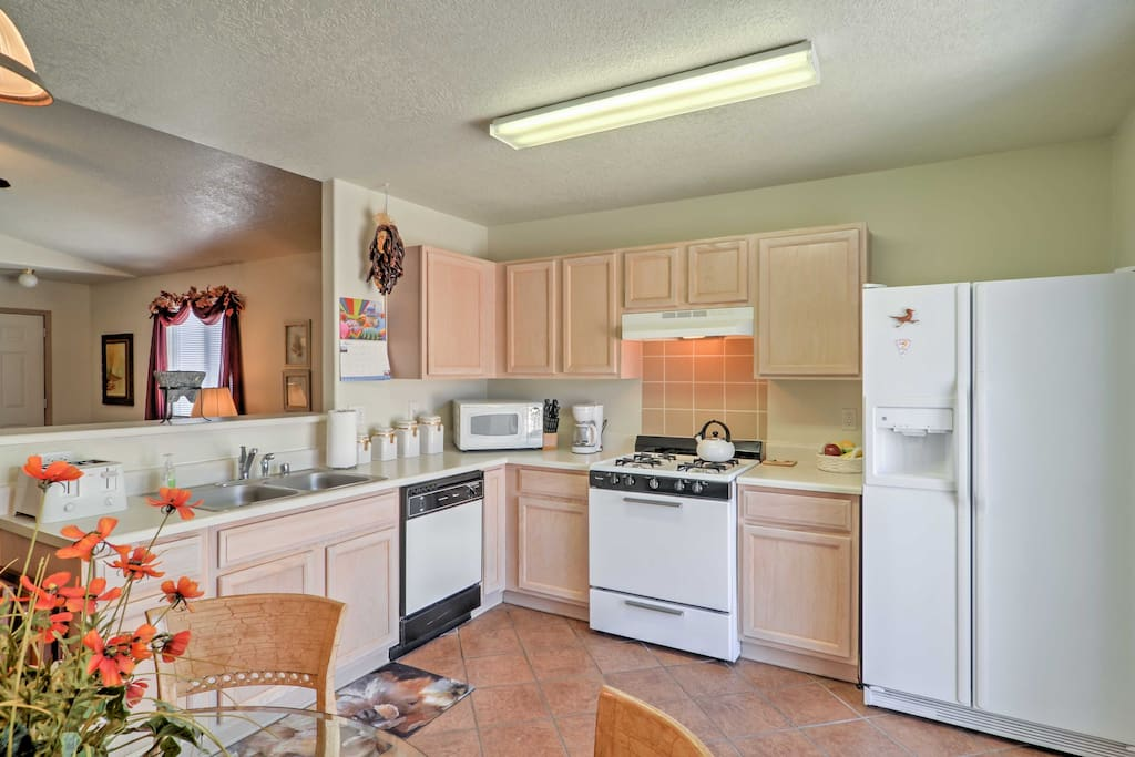 The fully equipped kitchen is perfect for whipping up home-cooked meals.