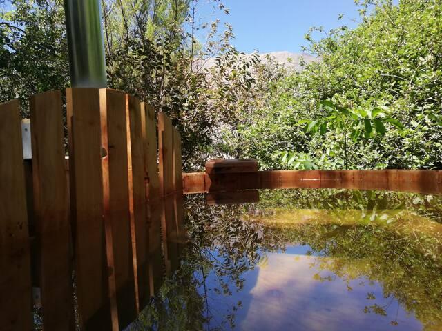Casa con Tinaja de agua caliente y piscina