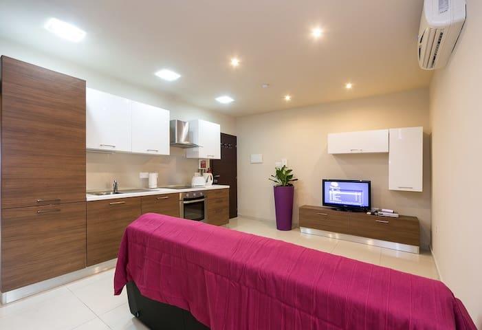 Plum Aparthotel