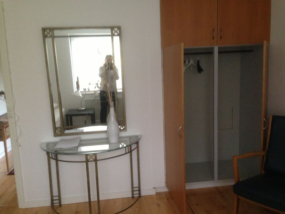 The cupboard for your clothes, and a mirror.
