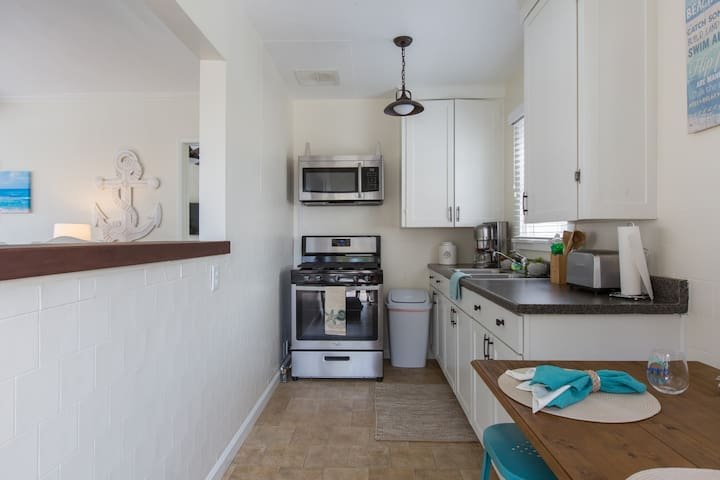 Try the amazing local restaurants OR cook your own mean with everything you need right in this kitchen.