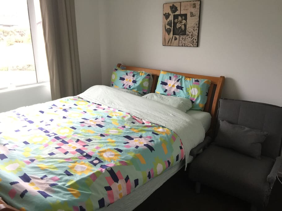 king size double bed.Comfortable Rimu bed and a folded futon sofa bed.