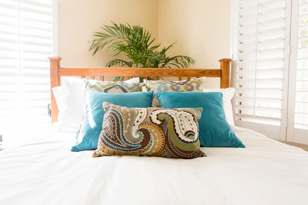 Natural light, plantation shutters and down filled, cotton covered comforter-all ready for you to sink in to.