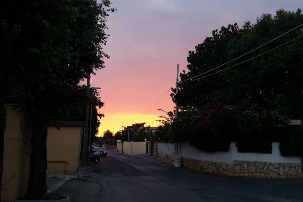Beautiful sunset in the warm summer evening in Anzio. You can see the entrance to our apartment by the yellow wall here on the left side of the picture.