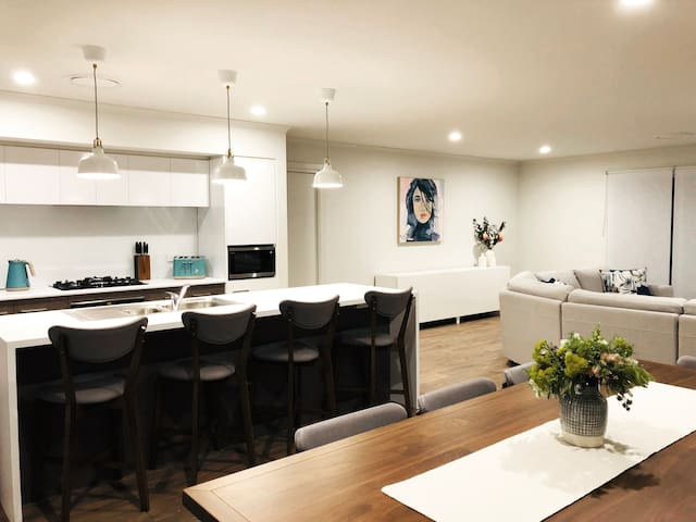 The open plan living space is modern and comfortable.