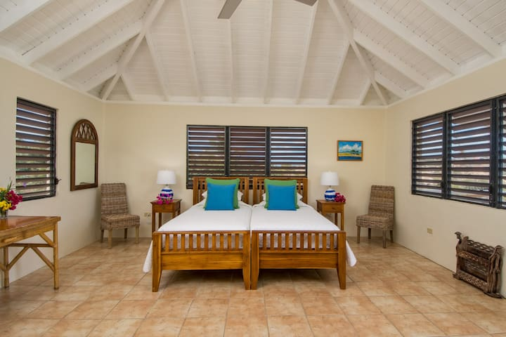One of the guest bedrooms can be made with twin beds or a king bed.