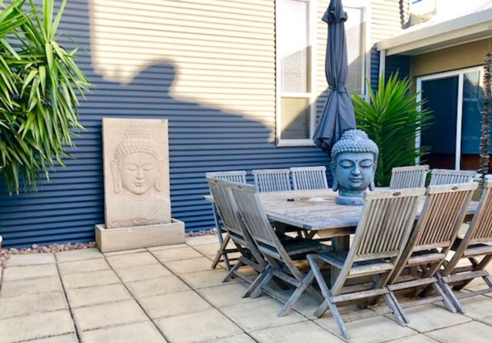 Private outdoor entertaining ..seating for 10 overlooks the back yard .
