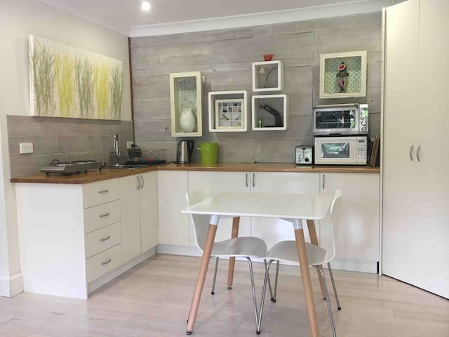 Open plan kitchenette and step-in pantry.