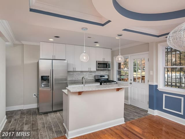 The kitchen has brand new appliances and granite counters