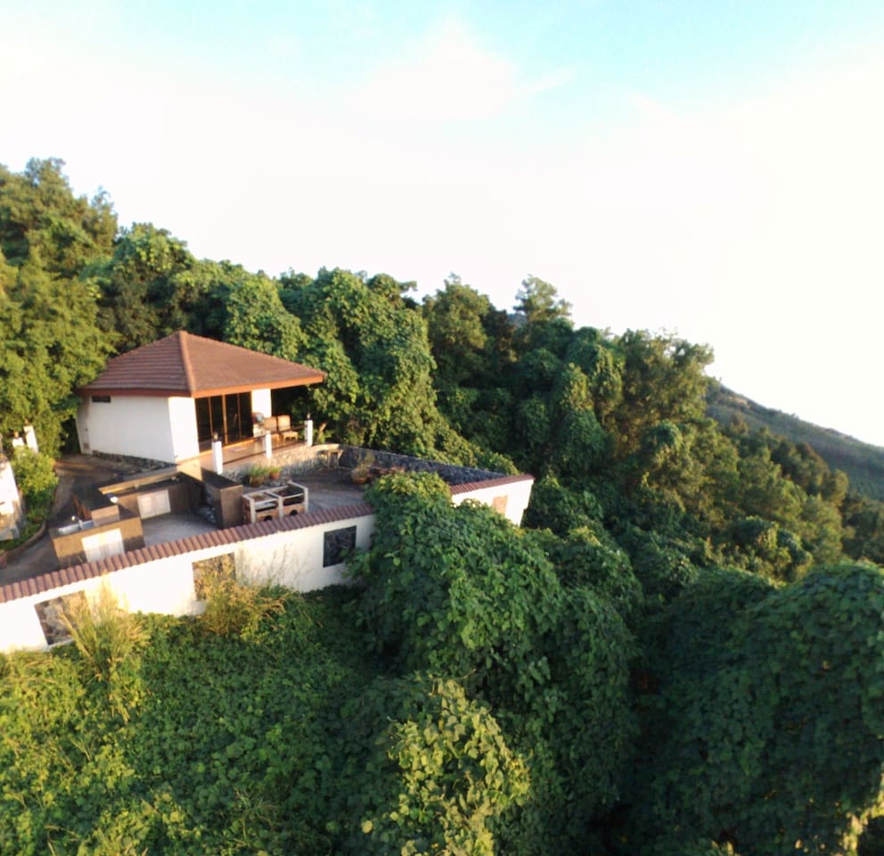 perched on a hillside up again lush jungle