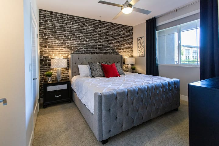 """King Master bedroom with ensuite bathroom, large closet, dresser,  50 """" TV, and beautiful view of the pool. Our bed is memory foam for added comfort and our bedding is high quality and professionally laundered."""
