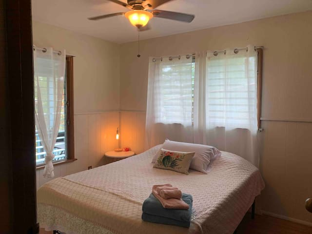 Luxury bed in private room with back lanai