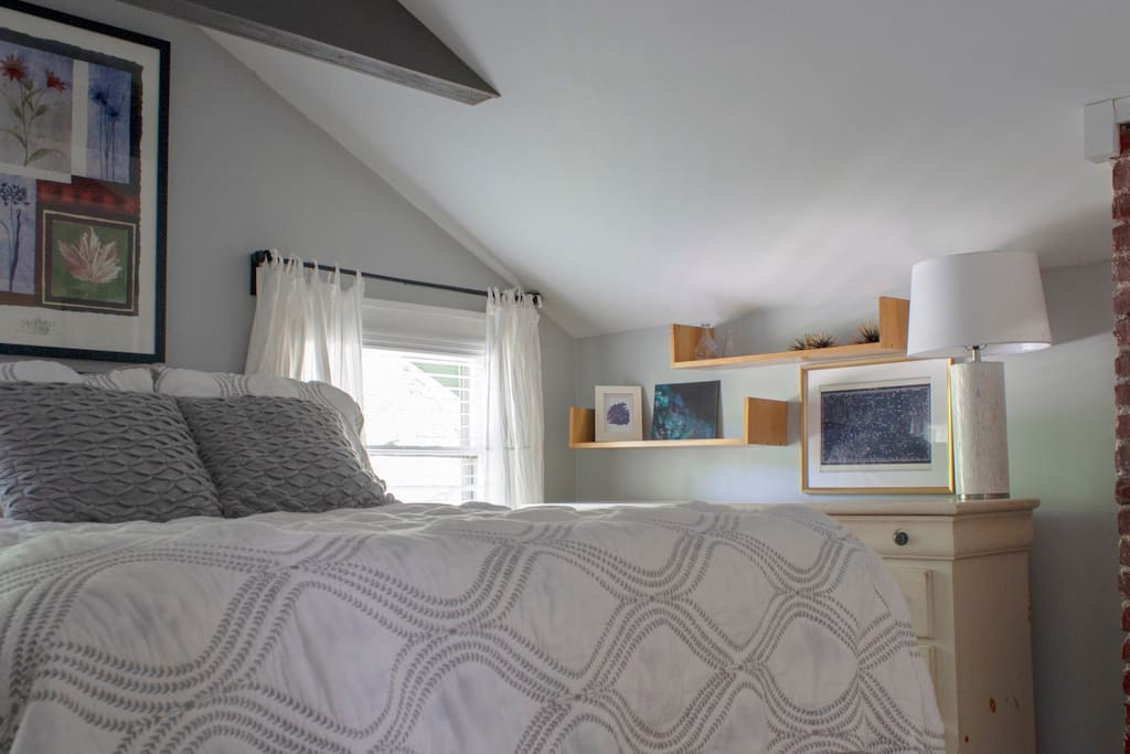 The bedroom can also be bright and airy with a closet, full dresser, and armoire for storage.
