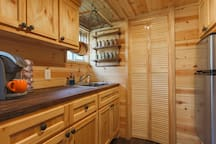 gourmet kitchen with spices and all items needed to cook.