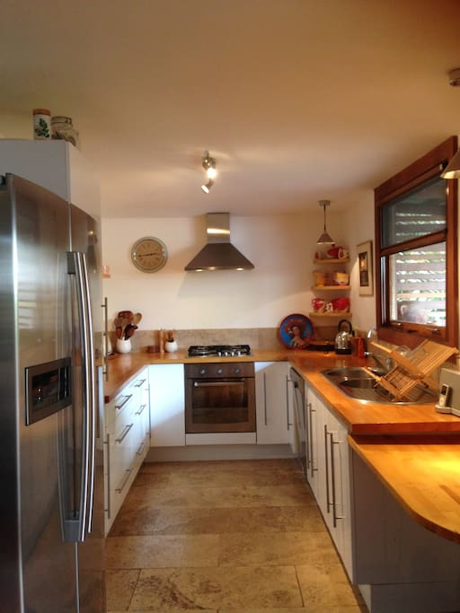 Functional kitchen with servery opening to deck