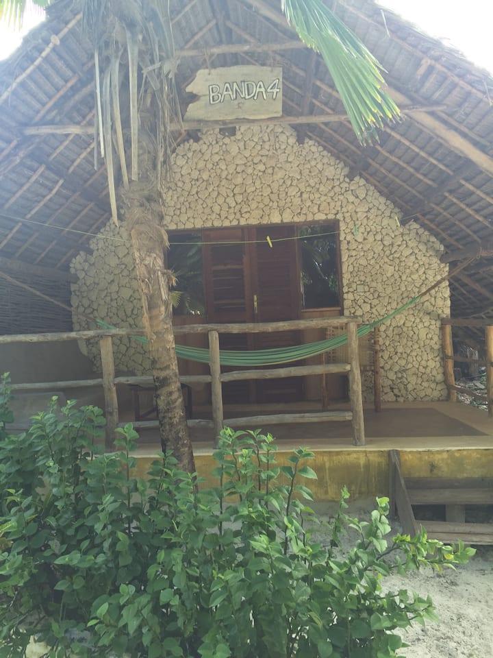 Mbuyuni  beach  village-  (African style  hut)