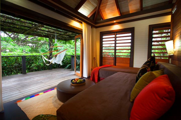 The bungalow lounge is perfect for your creative endeavors or can be configured for sleeping, with either two single beds or a king-size bed.