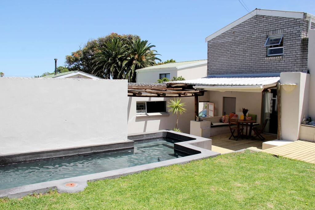 The back garden is sheltered from the wind and with the barbeque and sheltered deck provides the perfect entertainment area.