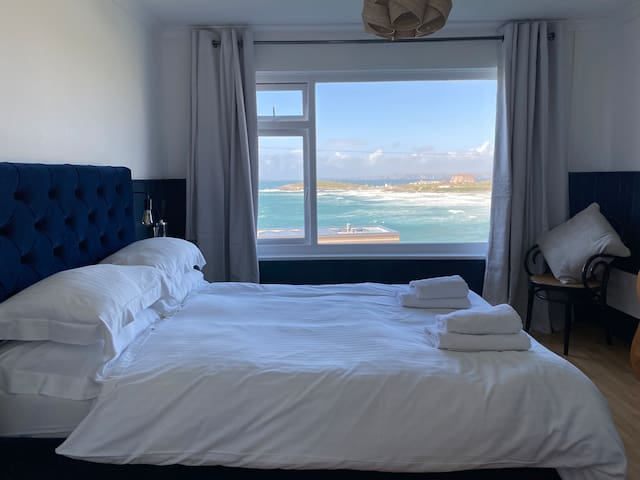 What a view - from your bed  The double velvet bed provides the best place to watch: -surfers -the weather rolling in and out  - or switch off and enjoy the rhythm of the ocean.  Sleep with the curtains open, or for good shuteye, they're blackout!
