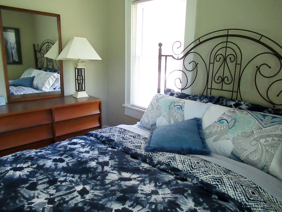 A queen bed in the master bedroom with wall to wall closet.
