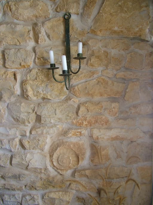 Exposed stone wall in the lounge