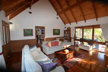 Comfortable lounge with log fire, plenty of books and surround sound.