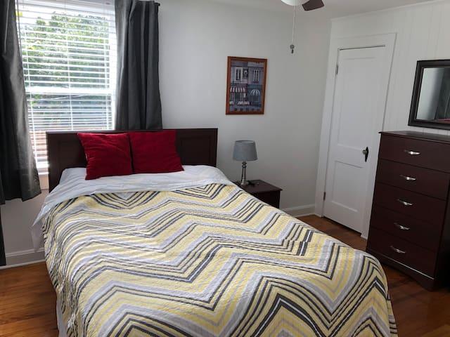 Queen Size Bed, view of door to closet. We have Roku and smart TV.