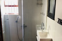Small bathroom with spacious shower and strong water pressure. (no bath)